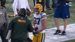 Jordy Nelson tries to rescue Coach Rei... McCarthy from a bone-headed illegal challenge.